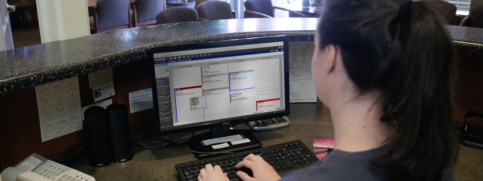 Image of Person Using DentiMax Dental Software